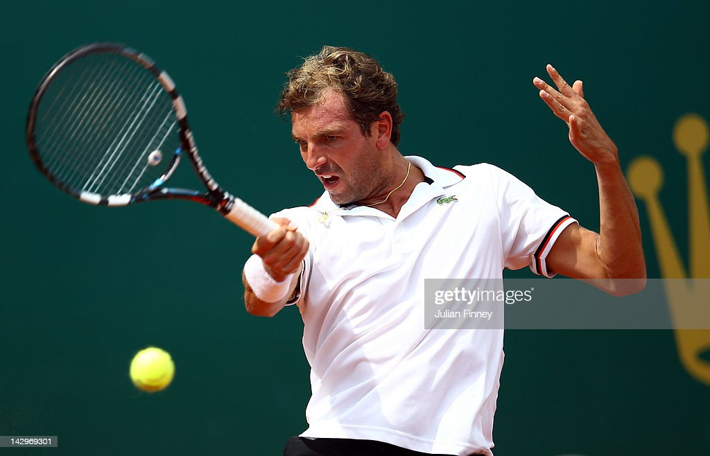 Julien Benneteau of France plays a forehand in his match against Marcel Granollers of Spain during day two of the ATP Monte Carlo Masters on April 16, 2012 in Monte-Carlo, Monaco.