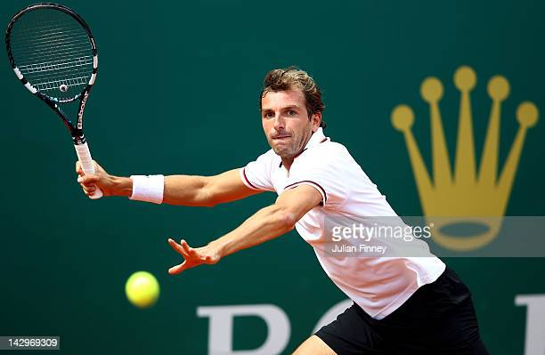 Julien Benneteau of France plays a forehand in his match against Marcel Granollers of Spain during day two of the ATP Monte Carlo Masters on April 16...