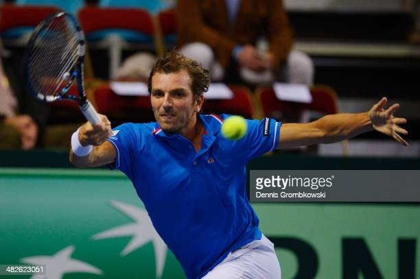 Julien Benneteau of France plays a forehand in his match against Tobias Kamke of Germany during day 1 of the Davis Cup Quarter Final match between...