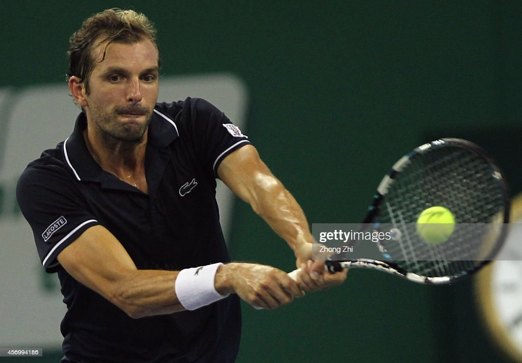 Julien Benneteau of France returns a shot during the Men's Singles Quarterfinal match against Roger Federer of Switzerland during the day 6 of the Shanghai Rolex Masters at the Qi Zhong Tennis Center on October 10, 2014 in Shanghai, China.