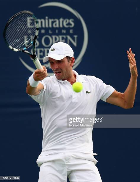 Julien Benneteau of France returns a shot to Lleyton Hewitt of Australia during Rogers Cup at Rexall Centre at York University on August 4 2014 in...