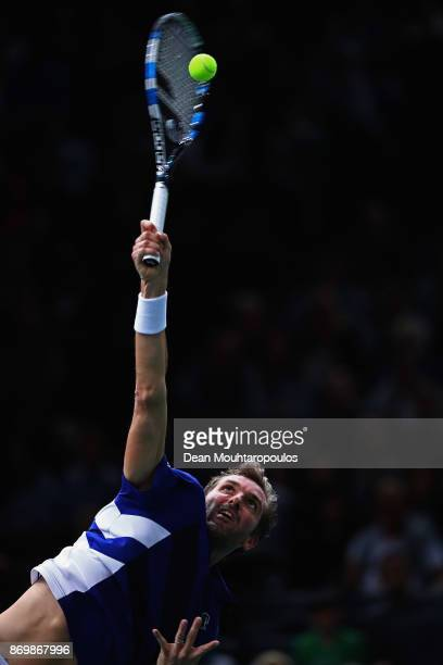Julien Benneteau of France serves against Marin Cilic of Croatia during Day 5 of the Rolex Paris Masters held at the AccorHotels Arena on November 3...