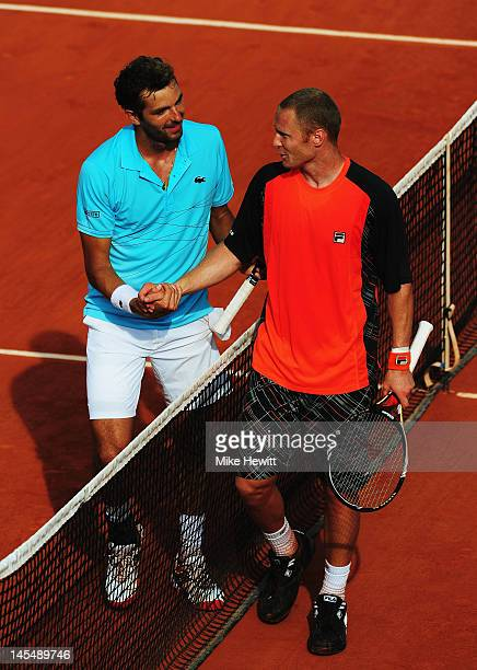 Julien Benneteau of France shakes hands with Dmitry Tursunov of Russia after their men's singles second round match during day 5 of the French Open...