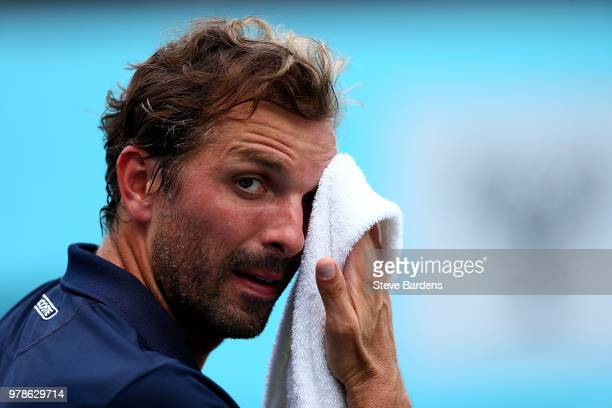 Julien Benneteau of France wipes his face during his match against Tomas Berdych of The Czech Republic on Day Two of the FeverTree Championships at...