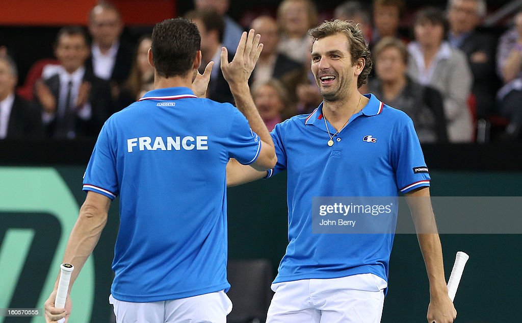 Julien Bennetteau and Michael Llodra (L) of France celebrate their victory after their doubles match against Jonathan Erlich and Dudi Sela of Israel on day two of the Davis Cup first round match between France and Israel at the Kindarena stadium on February 2, 2013 in Rouen, France.