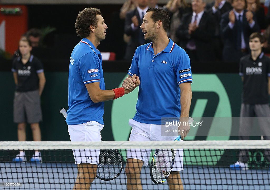 Julien Bennetteau and Michael Llodra of France celebrate their victory after their doubles match against Jonathan Erlich and Dudi Sela of Israel on day two of the Davis Cup first round match between France and Israel at the Kindarena stadium on February 2, 2013 in Rouen, France.