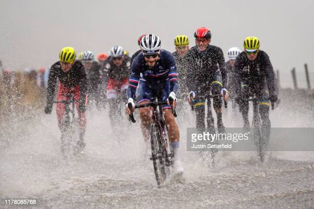 Julien Bernard of France passes through the flooded race route on Cray Summit during the 92nd UCI Road World Championships 2019 Men Elite Road Race a...