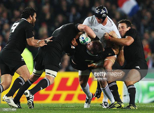 Julien Bonnaire of France lifts Richie McCaw of the All Blacks during the IRB 2011 Rugby World Cup Pool A match between New Zealand and France at...