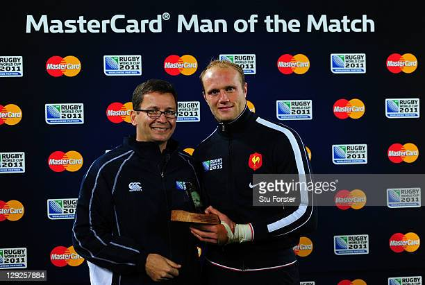 Julien Bonnaire of France recevies his man of the match award after the semi final one of the 2011 IRB Rugby World Cup between Wales and France at...