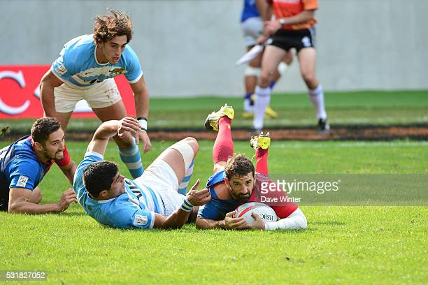Julien Candelon of France and Axel Muller of Argentina during the HSBC PARIS SEVENS tournament at Stade Jean Bouin on May 15 2016 in Paris France