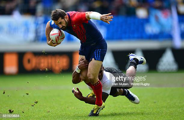 Julien Candelon of France is tackled by Josua Tuisova of Fiji during the Cup Semi Final match between France and Fiji on day three of the HSBC Paris...