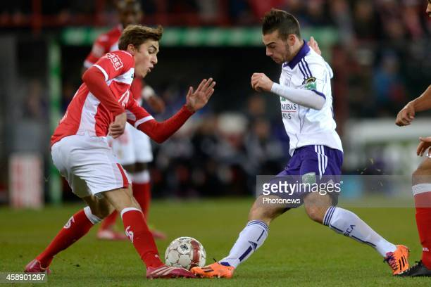 Julien De Sart of Standard battles for the ball with Massimo Bruno of RSC Anderlecht during the Jupiler League match between Standard Liege and RSC...