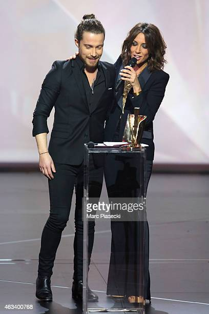 Julien Dore receives from Virginie Guilhaume the award for the male artist of the year during the 30th 'Victoires de la Musique' French Music Awards...
