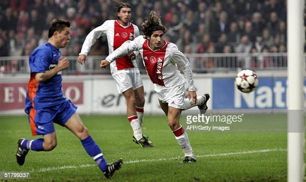Julien Escude of Ajax Amsterdam scores against RBC Roosendaal during their Dutch premier league match 28 November 2004 in Amsterdam At left RBC's...