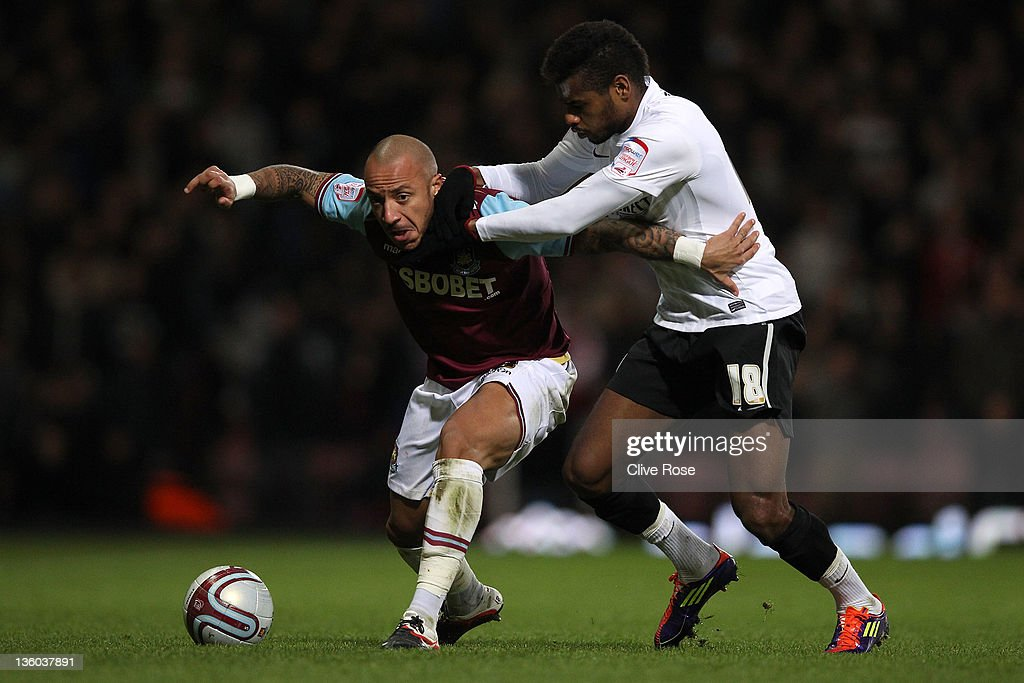 Julien Faubert of West Ham United is challenged by Ricardo Vaz Te of Barnsley during the npower Championship match between West Ham United and Barnsley at the Boleyn Ground on December 17, 2011 in London, England.