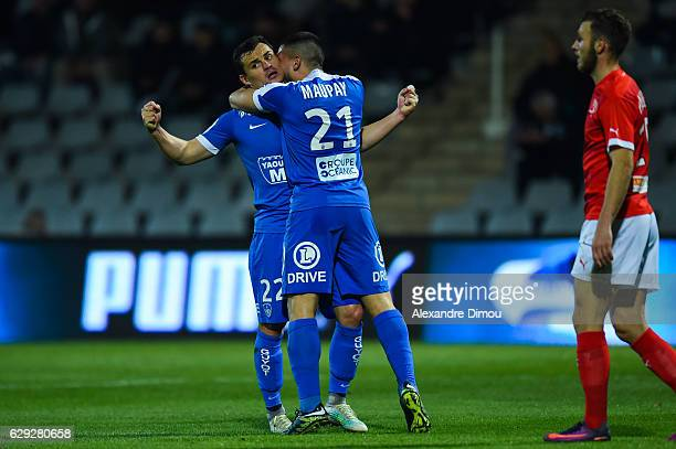 Julien Faussurier and Neal Maupay of Brest celebrates one Goal during the French LIgue 2 match between Nimes and Brest at Stade des Costieres on...