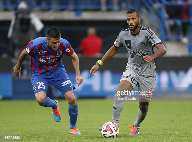 Julien Feret of Caen and JacquesAlaixys Romao of OM in action during the French Ligue 1 match between Stade Malherbe de Caen and Olympique de...