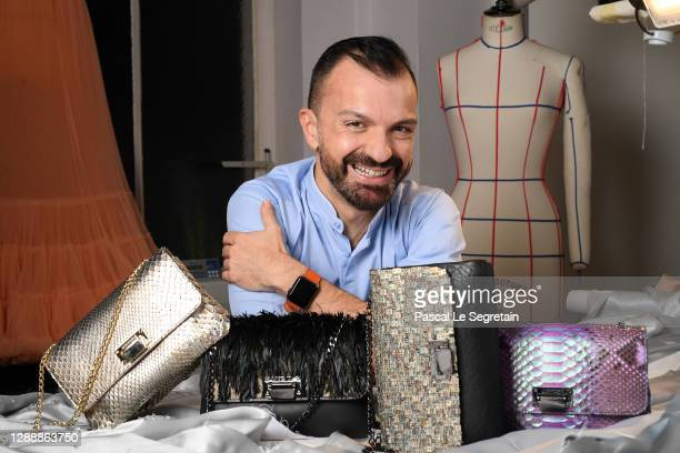 Julien Fournié poses in his atelier with his Haute Couture handbags during Julien Fournié's Haute Couture website launch on December 01, 2020 in...