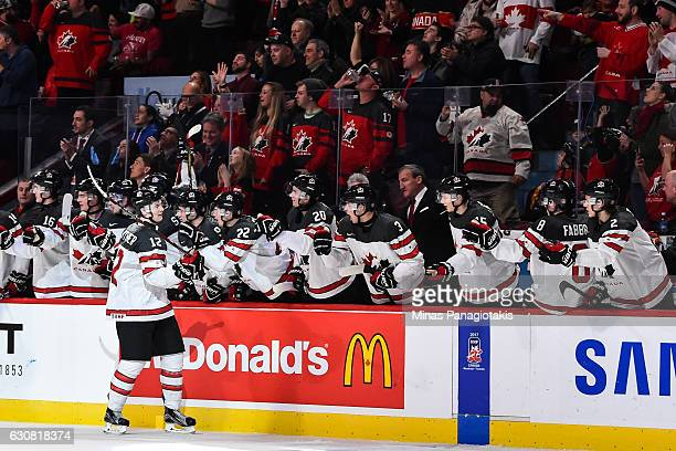Julien Gauthier of Team Canada celebrates a third period goal with teammates on the bench during the 2017 IIHF World Junior Championship quarterfinal...