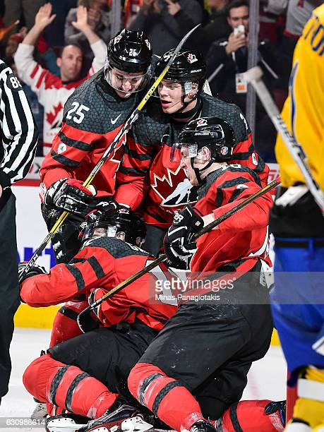 Julien Gauthier of Team Canada celebrates his second period goal with teammates during the 2017 IIHF World Junior Championship semifinal game against...