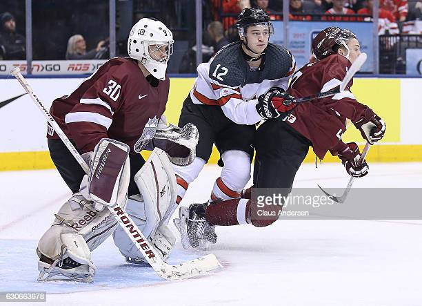 Julien Gauthier of Team Canada skates against Kristaps Zile of Team Latvia during a preliminary game in the 2017 IIHF World Junior Hockey...