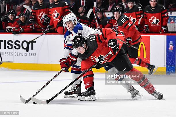 Julien Gauthier of Team Canada skates the puck against Tanner Laczynski of Team United States during the 2017 IIHF World Junior Championship gold...