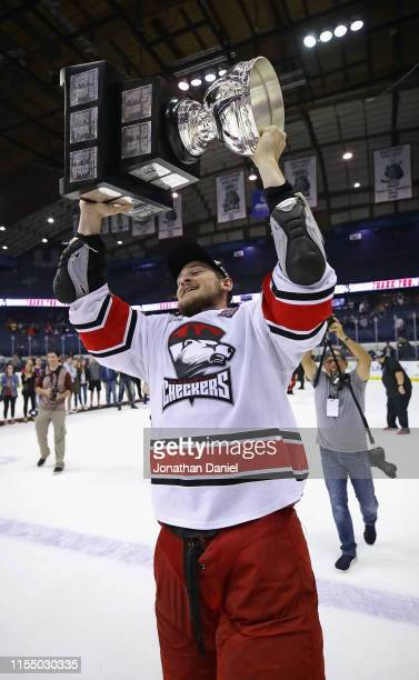 Julien Gauthier of the Charlotte Checkers holds the Calder Cup after a win over the Chicago Wolves during game Five of the Calder Cup Finals at...