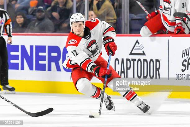 Julien Gauthier of the Charlotte Checkers in control of the puck shifts sides against the Laval Rocket at Place Bell on December 28 2018 in Laval...