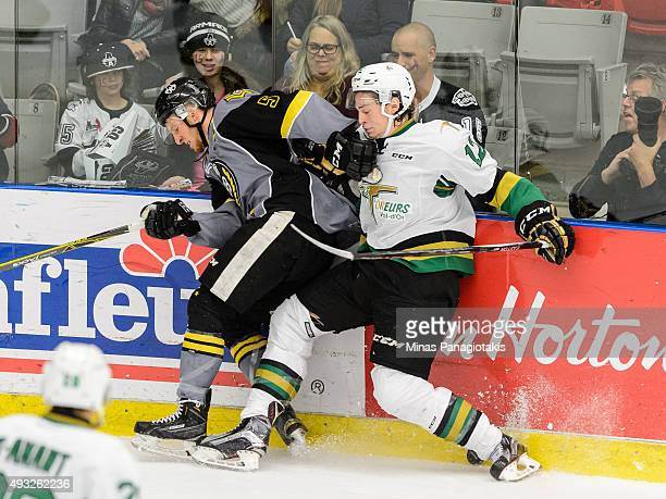 Julien Gauthier of the Vald'Or Foreurs and Nathanael Halbert of the BlainvilleBoisbriand Armada battle for the puck near the boards during the QMJHL...