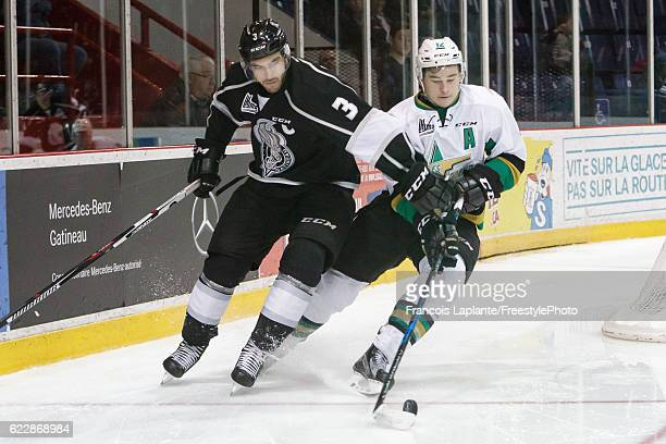 Julien Gauthier of the Vald'Or Foreurs controls the puck against MarcOlivier CrevierMorin of the Gatineau Olympiques on November 12 2016 at Robert...
