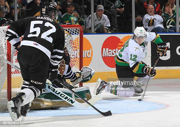 Julien Gauthier of the Val'Dor Foreurs looks to get a backhand past Anthony Stolarz of the London Knights in Game One of the 2014 Mastercard Memorial...