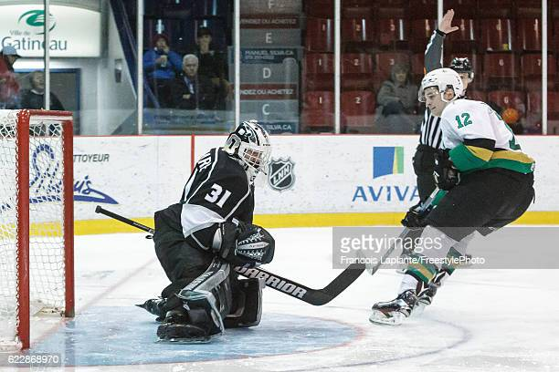 Julien Gauthier of the Vald'Or Foreurs puts the puck past Mathieu Bellemare of the Gatineau Olympiques on November 12 2016 at Robert Guertin Arena in...