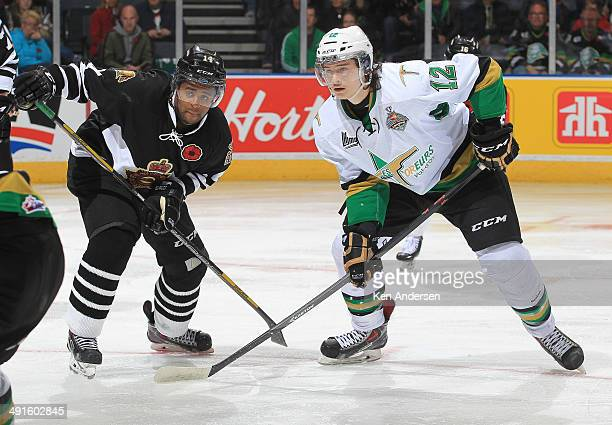 Julien Gauthier of the Val'Dor Foreurs skates against Gemel Smith of the London Knights in Game One of the 2014 Mastercard Memorial Cup at the...