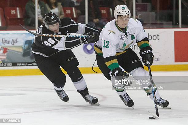 Julien Gauthier of the Vald'Or Foreurs skates with the puck against Zack MacEwen of the Gatineau Olympiques on November 12 2016 at Robert Guertin...