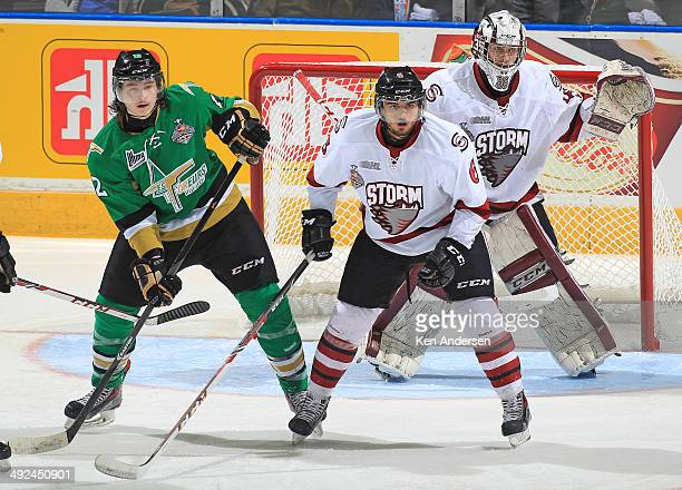 Julien Gauthier of the Val'Dor Foreurs waits for a shot to deflect next to Phil Baltisberger of the Guelph Storm in Game Four of the 2014 MasterCard...