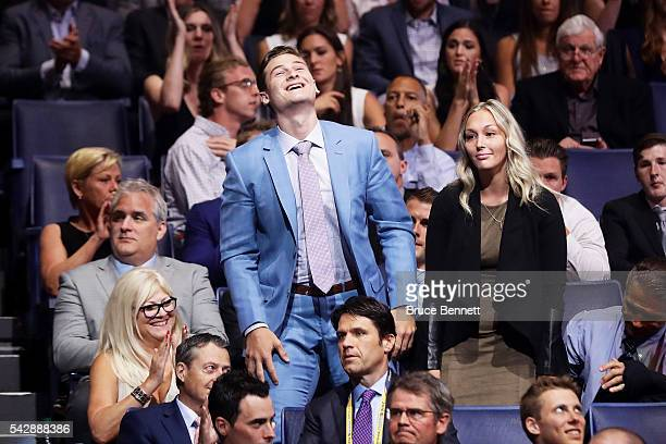 Julien Gauthier reacts after being selected 21st by the Carolina Hurricanes during round one of the 2016 NHL Draft on June 24 2016 in Buffalo New York