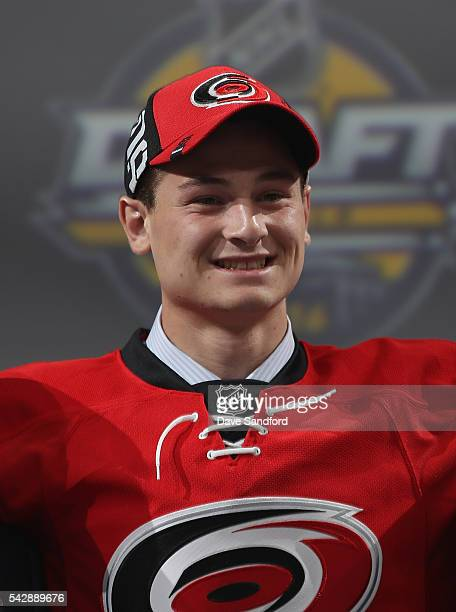 Julien Gauthier selected 21st overall by the Carolina Hurricanes poses onstage during round one of the 2016 NHL Draft at First Niagara Center on June...