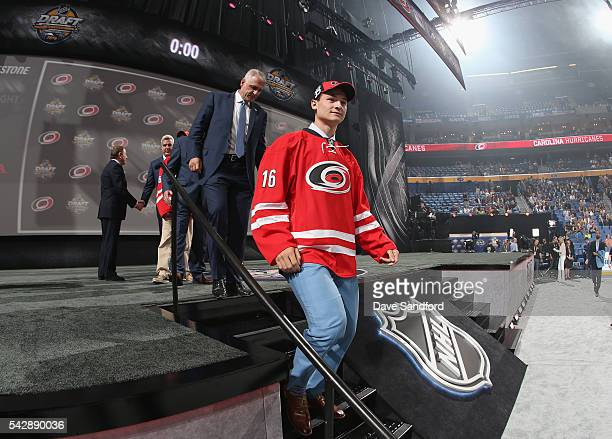 Julien Gauthier selected 21st overall by the Carolina Hurricanes walks onstage during round one of the 2016 NHL Draft at First Niagara Center on June...