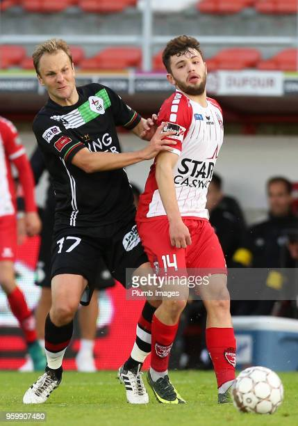 Julien Gorius of OH Leuven in action with Sebastjan Spahiu of Royal Excel Mouscron during the Belgian Playoff 2 tie between Royal Excel Mouscron and...