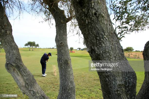 Julien Guerrier of France hits his second shot on the 9th hole during Day Three of the Portugal Masters at Dom Pedro Victoria Golf Course on...