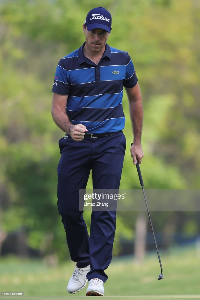Julien Guerrier of France reacts after the plays a shot during the day three of the 2018 Volvo China Open at Topwin Golf and Country Club on April 28, 2018 in Beijing, China.