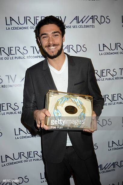 Julien Guirado from Secret Story 7 is awarded a Lauriers TV 2014 award during the 'Lauriers TV Awards 2014 Ceremony' Red Carpet Arrivals At La Cigale...