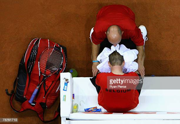 Julien Hoferlin, Belgian Team Captain, speaks to Kristof Vliegen of Belgium during his match against Chris Guccione of Australia during day three of...