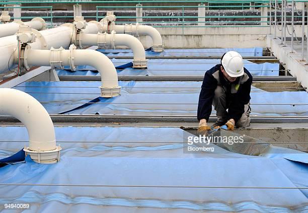 Julien Houziaux checks a filtration system at a Suez Lyonnaise Des Eaux water treatment plant in Le Pecq near Paris France on Thursday Feb 26 2009...