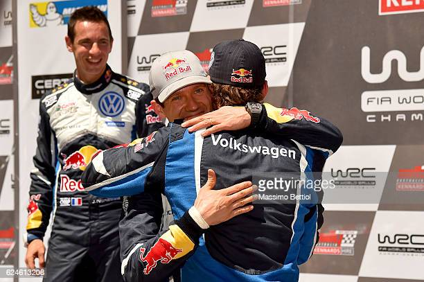 Julien Ingrassia of France and Sebastien Ogier of France congratulate their team mate Andreas Mikkelsen of Norway during Day Three of the WRC...