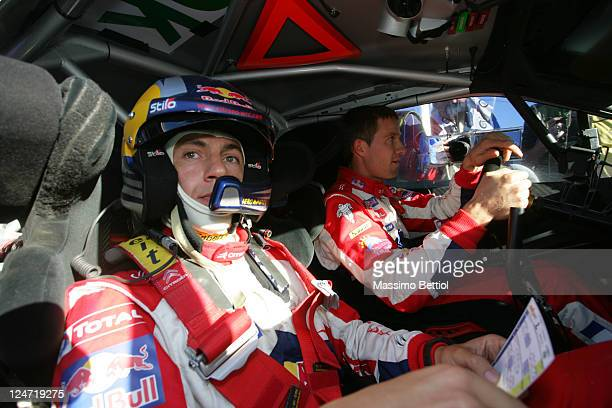 Julien Ingrassia of France and Sebastien Ogier of France inside the cockpit of their Citroen Total WRT Citroen DS3 WRC during Day3 of the WRC Rally...