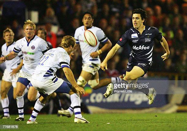 Julien Laharrague of Sale Sharks chips the ball over the head of Nick Abendanon of Bath during the EDF Energy Cup match between Sale Sharks and Bath...