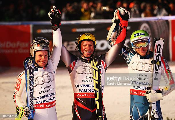 Julien Lizeroux of France Ivica Kostelic of Croatia and Bode Miller of the USA celebrate after the Parallel Slalom of the FIS Skiing World Cup at the...