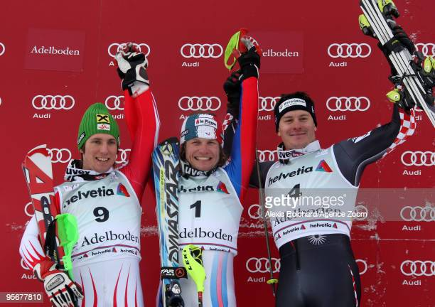 Julien Lizeroux of France takes 1st place Marcel Hirscher of Austria takes 2nd place and Ivica Kostelic of Croatia takes 3rd place during the Audi...