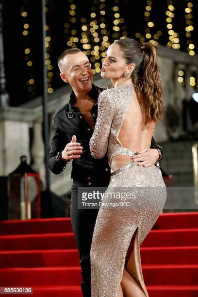 Julien Macdonald and Izabel Goulart attend The Fashion Awards 2017 in partnership with Swarovski at Royal Albert Hall on December 4 2017 in London...
